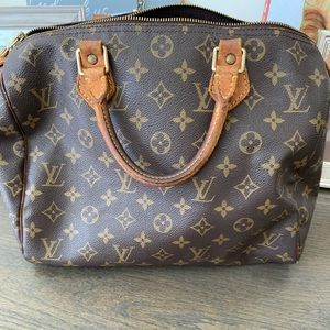 Speedy 30  Louis Vuitton.  USED CONDITIONS.